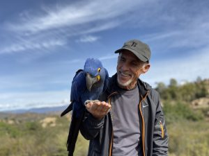 man with hyacinth macaw